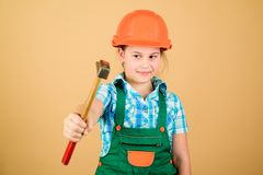 Labor day. 1 may. Foreman inspector. Repair. Safety expert. Future profession. small girl repairing in workshop. Little. Girl in helmet with hammer. Kid worker stock images