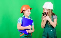 Labor day. 1 may. school project. Foreman inspector. Repair. Little kids in helmet with tablet. small girls repairing royalty free stock photo