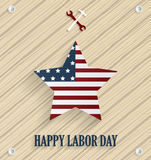 Labor day poster with striped star, wrench and hammer. Wooden background Stock Photography