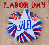Labor Day Sale. Image of a swirl of red white and blue stars with United States toothpick flags on wooden background with  message stock images