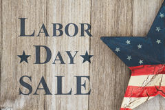Retro Labor Day Sale message. Labor Day sale message, USA patriotic old star on a weathered wood background with text Labor Day Sale stock photos