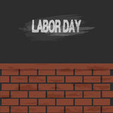 Labor day text and brick wall background Stock Photo