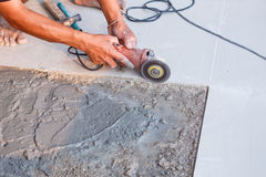 Labor installing tile floor for new house building Royalty Free Stock Photos
