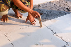 Labor installing tile floor for new house building Stock Photography