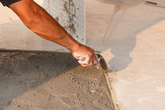 Labor installing tile floor for new house building Royalty Free Stock Image
