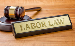 Labor Law. A gavel and a name plate with the engraving Labor Law Royalty Free Stock Image