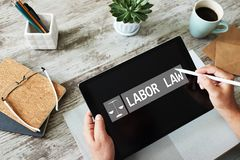 Labor law icon and text on device screen. stock image