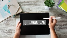 Labor law icon and text on device screen. royalty free stock photo