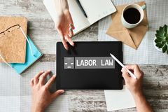 Labor law icon and text on device screen. stock photography
