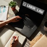 Labor law icon and text on device screen. royalty free stock image