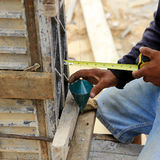 Labor man using a plumb bob for check Royalty Free Stock Photography