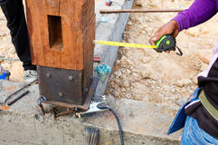 Labor man using a plumb bob for check pillar Royalty Free Stock Images