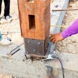Labor man using a plumb bob for check pillar Stock Images