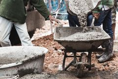 Labor work concrete with cart. Industrial construction labor work concrete mix with cart Royalty Free Stock Images