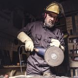 Man with grinder in action royalty free stock images