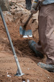 Labor work with spade for excavation Stock Images
