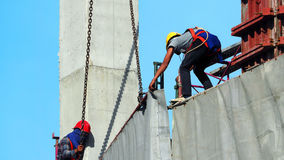 Labor working on construction site. Royalty Free Stock Photo