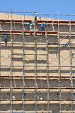 Labor working on high scaffold in construction site. Of thailand Royalty Free Stock Photos