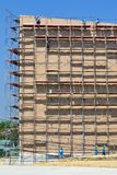 Labor working on high scaffold in construction site. Of thailand Royalty Free Stock Photo