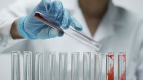 Laboratorian adding dry test material into tubes, conducting research in lab. Stock footage stock video