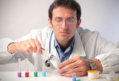 Laboratory. Doctor filling some test tubes in a laboratory Royalty Free Stock Photography