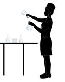 Laboratory assistant. Black silhouette of a laboratory assistant on a white background Stock Photos