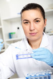Laboratory assistant analyzing a liquid Royalty Free Stock Photos