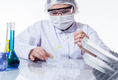 Laboratory assistant analyzing a sample Stock Photos