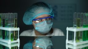 Laboratory assistant looking to camera, scientist conducting experiment research. Stock footage stock video