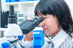 Laboratory assistant at microscope Royalty Free Stock Photo