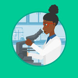 Laboratory assistant with microscope. Stock Image