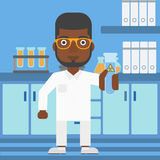 Laboratory assistant with test tube. Royalty Free Stock Photography