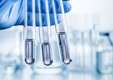 Laboratory beakers in analyst`s hand. royalty free stock photo