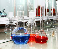 Laboratory beakers with the coloured liquid Stock Photo