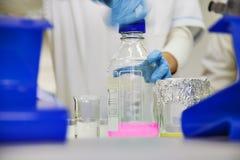 Laboratory bottle solution Stock Image