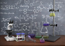 Laboratory chemical test tubes and objects on the table with ch. Emistry draw on whiteboard Royalty Free Stock Images