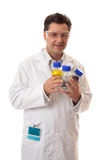 Laboratory chemist holding bottles of chemicals Royalty Free Stock Photos