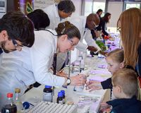 Laboratory chemists tak a day out of the lab to teach children about chemistry as part of the UK STEM, science, technology,engine stock photography
