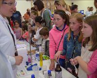Laboratory chemists take a day out of the lab to teach children about chemistry as part of the UK STEM, science, technology,engine. UK,ROTHLEY - 29 OCTOBER 2015 stock image