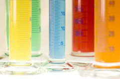 Laboratory cylinders. Test tubes isolated fulled with different color chemicals Royalty Free Stock Images