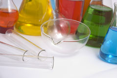 Laboratory Equipment. Test tubes, bowl and beakers containing colorful chemicals in a laboratory Stock Image