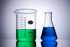 Laboratory equipment beakers front on Royalty Free Stock Photos
