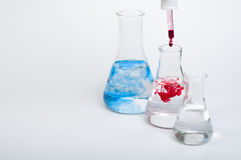 Laboratory equipment and color chemicals Stock Photo