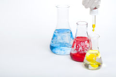 Laboratory equipment and color chemicals Stock Photos