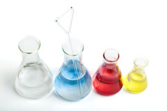 Laboratory equipment and color chemicals Royalty Free Stock Photo