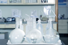Laboratory equipment, glass flasks in laboratory interior. Royalty Free Stock Photo