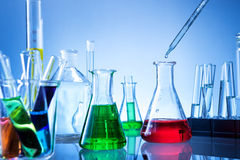 Laboratory equipment, lots of glass filled with colorful liquids Stock Photos