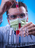 Laboratory equipment,  Man in the lab experimenting Stock Image