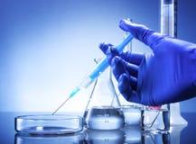 Laboratory equipment, syringe in hand glass bowl Stock Photos