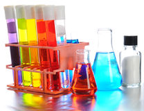 Laboratory Equpiment. Closeup of scientific laboratory equipment on shiny metal surface. Test tubes, beakers and vials filled with colorful liquids on a white Royalty Free Stock Photo